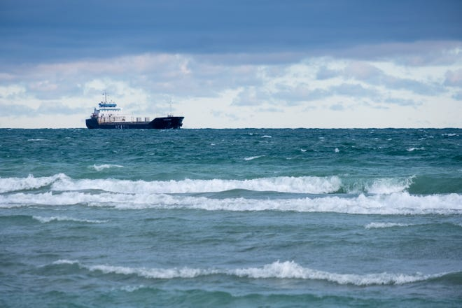 A freighter is seen on Lake Huron Thursday, Jan. 7, 2021, in Port Huron. Officials say Lake Michigan-Huron was 31 inches above average in December but four inches lower than it was last year.