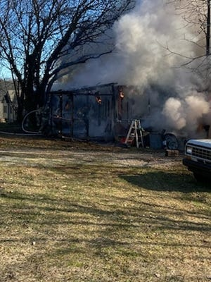 A blaze destroyed this Jackson Township mobile home in the 6300 block of Pine Road on Jan. 7, 2021, and injured the 88-year-old man who lived there, officials said.