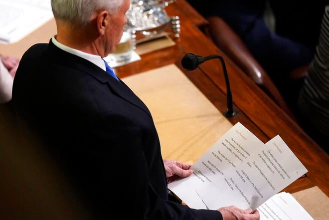 Vice President Mike Pence announces the election of President and Vice President as he officiates a joint session of the House and Senate to confirm Electoral College votes at the Capitol, early Thursday, Jan 7, 2021, in Washington. (AP Photo/Andrew Harnik)