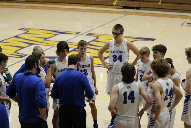 Centerville boys basketball head coach Mark Wilson talking to his team during a timeout in the 2021 Wayne County Tournament on Wednesday, Jan. 6.
