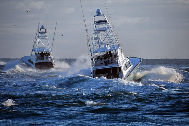 Waterman, skippered by Capt. Kevin Paul of Fort Pierce, in the foreground, departs Fort Pierce Inlet on Jan. 6, 2021 during the second day of fishing in the Pelican Yacht Club Billfish Invitational.