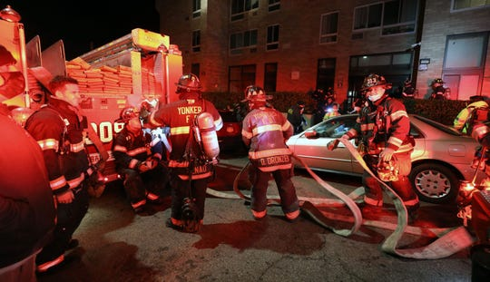 Yonkers firefighters tackled an apartment fire during the 4-alarm blaze in a high-rise building at 1 Glenwood Avenue in the city on Jan. 6, 2021. Numerous Empress ambulances and Yonkers police responded to the scene because reports were high in town was the building that reported the fire scanner needed assistance.
