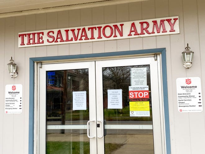 Signs are posted outside The Salvation Army announcing the closure of its pantry and soup kitchen for the remainder of the week.