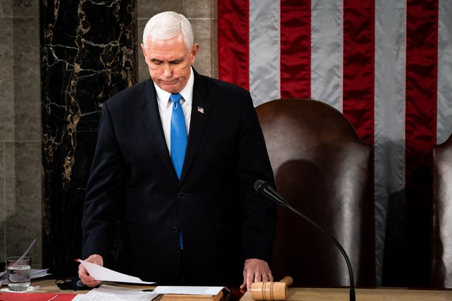 Vice President Mike Pence presides over a joint session of Congress to certify the 2020 Electoral College results on January 6, 2021.