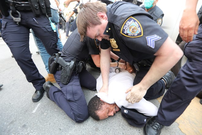 The protest gets heated in Foley Square in lower Manhattan May 29, 2020 to protest the death of George Floyd in Minneapolis earlier in the week.