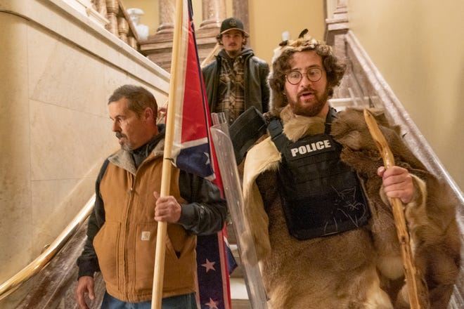 Pro-Trump rioters descend the stairs outside the Senate Chamber as violence erupted at the Capitol after mobs breached the security and stormed the U.S. Capitol, Jan. 6, 2021 in Washington.