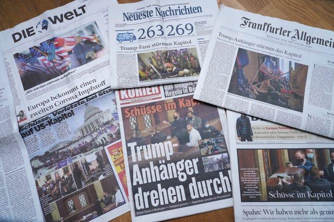 Les premières pages de journaux allemands montrent l'assaut des partisans du président Donald Trump du Capitole américain le 7 janvier 2021.