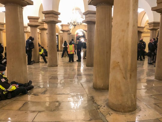 Police rest after protesters stormed the U.S. Capitol building in Washington, DC as the U.S. Congress meets to formally ratify Joe Biden as the winner of the 2020 Presidential election on Jan. 6, 2021.