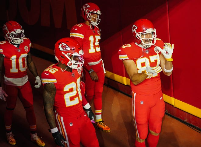 Kansas City Chiefs players, from left to right, Le'Veon Bell, Patrick Mahomes and Travis Kelce get ready to take the field at Arrowhead Stadium in early December. The Chiefs are the No. 1 playoff seed in the AFC.