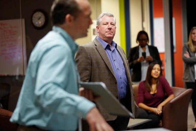 Austin American-Statesman Executive Editor John Bridges, right, will leave the Statesman in March after 32 years. He rose through the newspaper's editing ranks to serve as managing editor for seven years and executive editor for the past two.