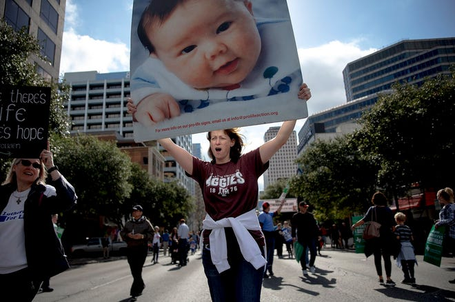 "Colleen Sullivan chants during an anti-abortion march in January 2019 in Austin. The event was part of annual ""March for Life"" events held across the country around the Jan. 22, 1973, anniversary of the Supreme Court's Roe v. Wade decision, which legalized abortion."