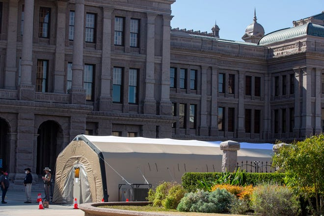 Visitors to the Texas Capitol can receive a free COVID-19 test in a tent erected near the north entrance. A test is recommended but not required. (Bronte Wittpenn / American-Statesman)