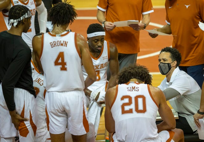 Texas men's basketball coach Shaka Smart, right, talks to his team during a timeout in Sunday's win over Iowa State. The fourth-ranked Longhorns can improve to 4-0 in the Big 12 on Saturday against 14th-ranked West Virginia.