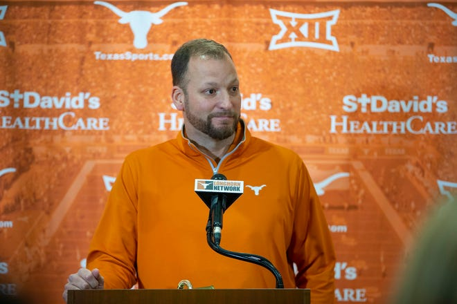 Texas offensive coordinator Mike Yurcich answers a question from the local news media on Feb. 11, 2020. Texas averaged 42.7 points and 475.4 yards per game in Yurcich's lone season with Texas. Both of those marks were an improvement for the Longhorns from 2019.