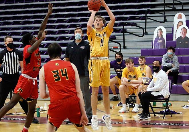 Ashland University's Hunter Shedenhelm puts up a 3-pointer over Ferris State's Jeremiah Washington during AU's 74-52 win Friday at Kates Gymnasium.