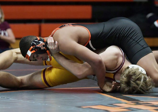 Ames' Brent Slade turns Ankeny's Ryan Allen on his back during their match at 145 pounds Thursday at Ames. Slade won by technical fall, 18-3 in 3:32,  but the Little Cyclones fell to the No. 7 Hawks, 54-17.
