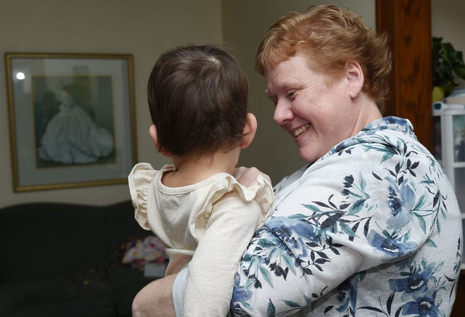 Missy Sanow, executive director of Martha's House of Hope, holds a baby at the house Friday, Jan. 8, 2021, in Ames, Iowa.