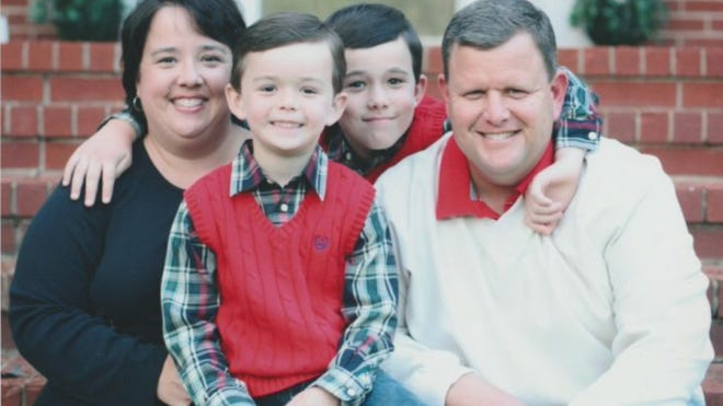 A family portrait shows Columbia County Fire Training Chief David Dickenson and his wife, Meredith, with their sons Landry, left, and Charlie.