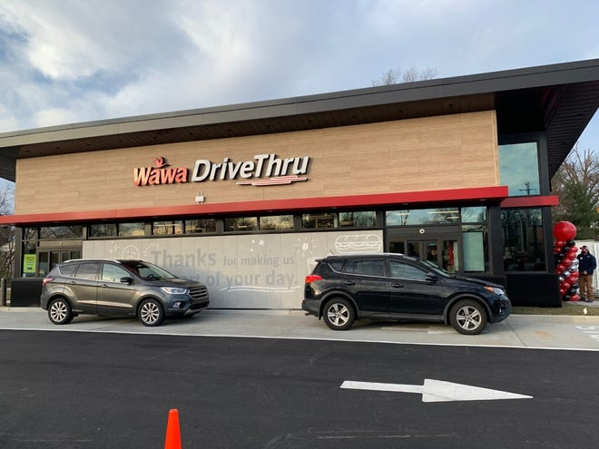 Customers in line at the first-ever Wawa drive-thru only standalone store that opened in Falls Friday.