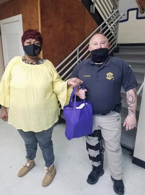 Charlotte Walker and the Beauregard Prevention Coalition donated nasal spray and hand sanitizer to patrol officers with the BPSO>