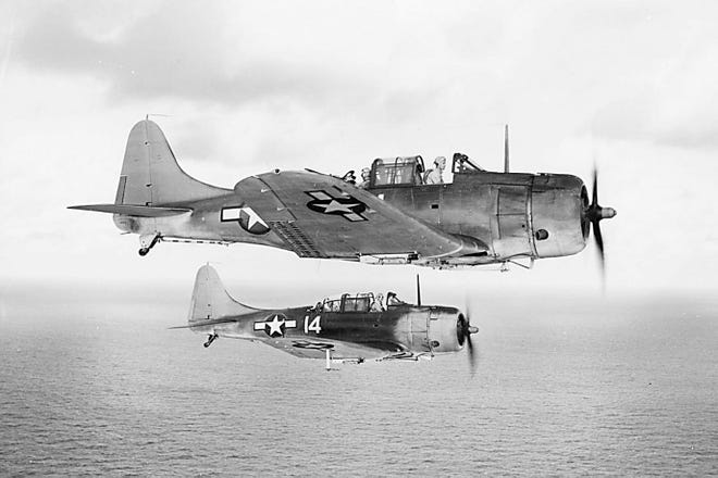 "The U.S. Navy Douglas SBD-5 ""Dauntless"" dive bomber was one of the planes Kenneth Spence flew in the military during World War II."