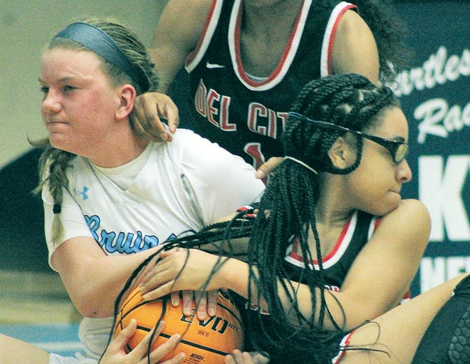 Bartlesville High senior Alli Wood, left, wrestles with a Del City High player during girls basketball  opening round action at the ConocoPhillips/Arvest Invitational.