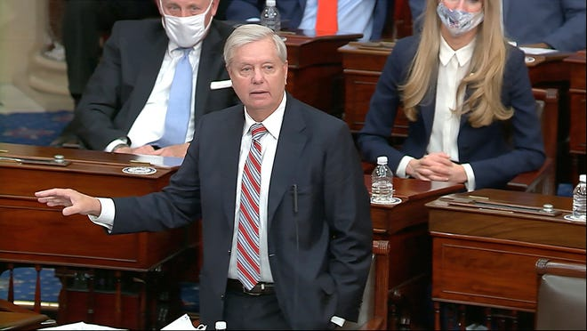 Sen. Lindsey Graham, R-S.C., speaks as the Senate reconvenes to debate the objection to confirm the Electoral College vote from Arizona after protesters stormed into the U.S. Capitol on Wednesday.