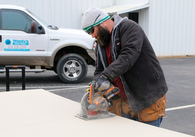Kreig Maxwell operates a saw as he helps make upgrades Friday morning to the children's ministry building at Freedom Fellowship Church in Early.