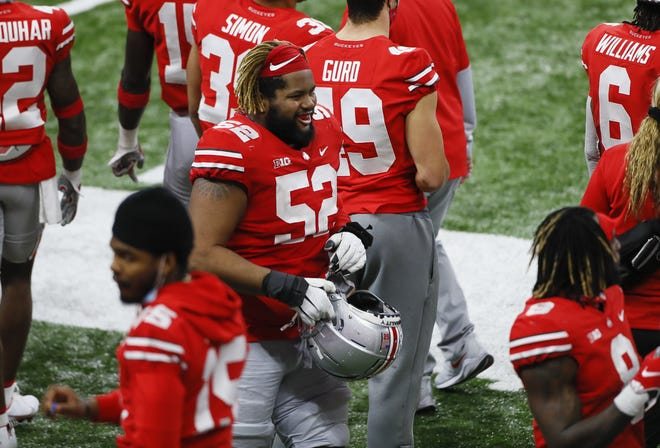 Ohio State right guard Wyatt Davis will enter the NFL draft.