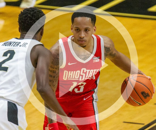 In this file photo, Ohio State Buckeyes guard CJ Walker (13) dribbles the ball against Purdue Boilermakers guard Eric Hunter Jr. (2) in the first half at Mackey Arena.