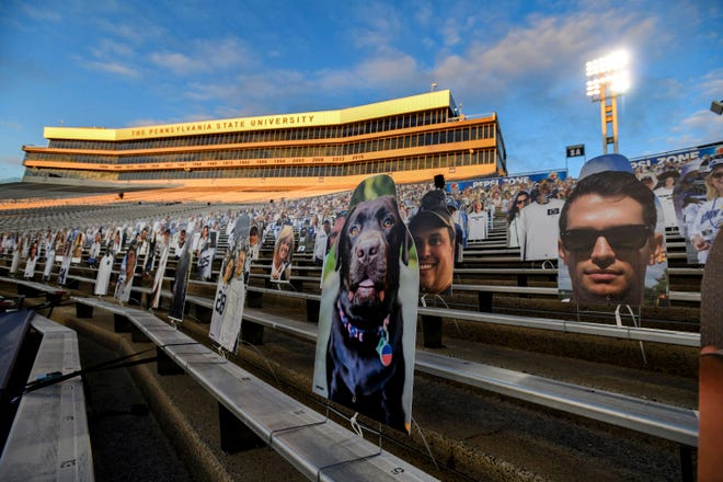 Cardboard cutouts of fans sit in the stands last October before a football game between host Penn State and Ohio State.