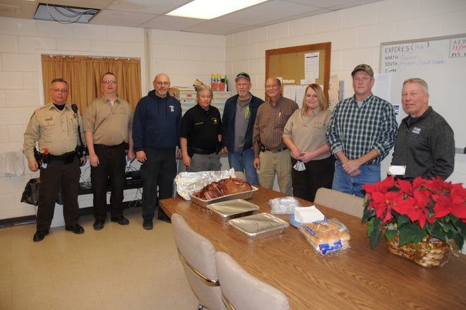 Illinois Fraternal Order of Police (FOP) Spoon River Valley Lodge 427 made working the holidays a little bit easier on local law enforcement as lodge members delivered Christmas Eve meals to on-duty law enforcement officers in Fulton and Mason Counties. Members of Lodge 427 are pictured with some of those who were on duty in Mason County.