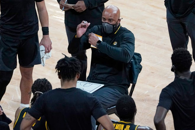 Missouri head coach Cuonzo Martin addresses his players in a timeout during a game against Mississippi State on Tuesday in Starkville, Miss.