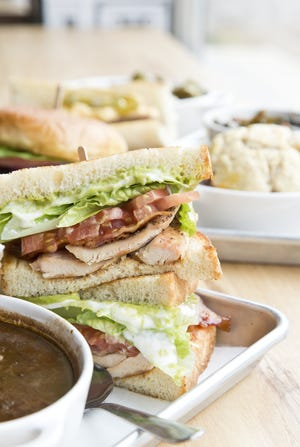 The we be clubbin' sandwich with other menu items at Addella's on Oak