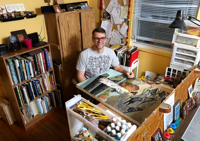 Artist Cody F. Miller poses in his home studio in Clintonville. Miller focuses his paint-and-paper works on the subject of grace. He often draws inspiration from his own life and events, such as those who helped him in a troubled childhood, or the current pandemic.