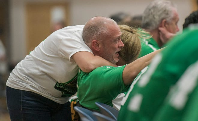Mount Dora Christian Christian Academy boys basketball coach Steven Hayes is hugged by his wife, Cherie, in the closing minutes of last year's Nathan Hayes Shootout tournament at MDCA. [PAUL RYAN / CORRESPONDENT]