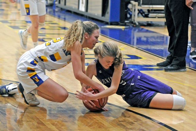 Wooster's Madison Kurtz and Lexington's Lizzie Hamler fight for a loose ball. Kurtz had a season-high 21 points in Wooster's win.