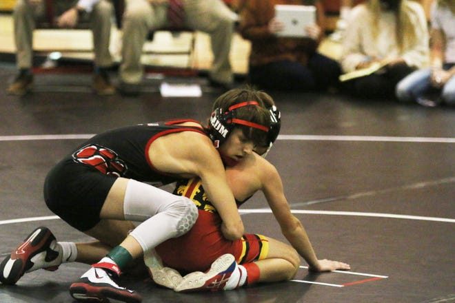 Jake Alexander at 106-pounds takes on a Carlisle opponent on Thursday, Jan. 7 during a home triangular in Adel.