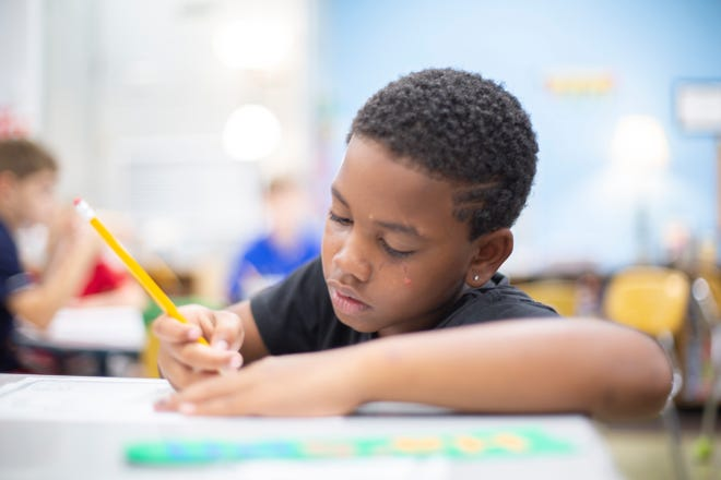 Ha'son Baugh, 9, attends his fourth grade class taught by Jennifer Potts at Joseph Brown Elementary School during the first day of classes at Maury County Public Schools on Thursday, Aug. 1, 2019.