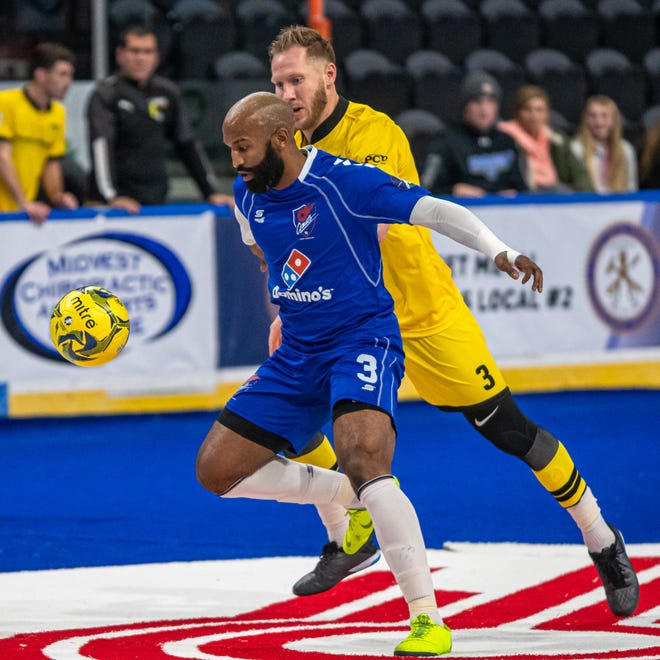 Kansas City Comets defender Ray Lee, front, shields the ball from Milwaukee's Chad Vandegriffe in a game last season. The Park Hlll High School graduate signed Thursday for his third season with the Comets.