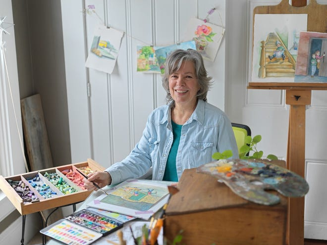 """Children's book author and illustrator Rebecca Matthews Vorkapich paints Thursday in the studio of her Burlington home. Vorkapich's first book, """"The Children of Horseshoe Hideout,"""" was released just before Christmas. It's the story of 11-year-old Hannah and her younger brothers, Wes and Jamie, who hide in an abandoned building to escape their nasty Aunt Olga."""