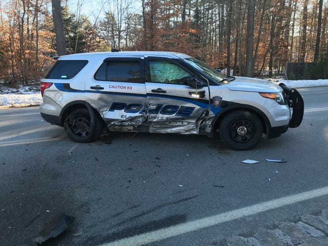 This Barrington Police Department cruiser and a sedan both sustained heavy damage, but no one was injured, during a head-on collision Friday morning that temporarily shut down part of Route 125 in Barrington.
