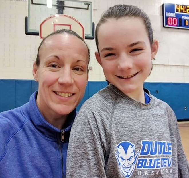 A member of the inaugural class of inductees into the Narragansett Athletic Hall of Fame in 2002, Leanne (Tourigny) Forbes (left) lives in Dudley and is a coach on her daughter Alyssa's youth basketball team.
