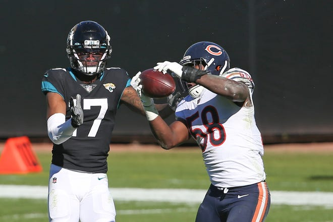 Chicago Bears linebacker Roquan Smith (58) intercepts a pass intended for Jacksonville Jaguars wide receiver DJ Chark Jr. (17) during the first half of a game on Sunday, Dec. 27, 2020, in Jacksonville, Fla.