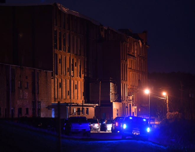 Investigators with the Spartanburg County Sheriff's Office and Spartanburg County Coroner's Office are on the scene at the old Converse Mill (Clifton Mill #3) along Oakland Street, off of Hwy. 29 in the Converse community, Thursday evening, January 7, 2021.