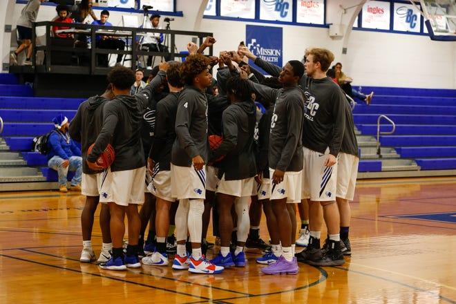 Brevard College's men's basketball team huddles during a game last year at Boshamer Gym.