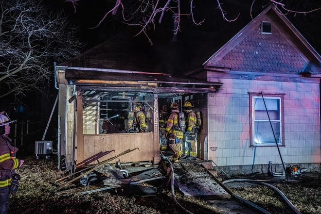 Hutchinson firefighters in the entrance of a home at 721 E. First Ave. that was damaged by fire Thursday night, making it uninhabitable. The cause of the fire remains under investigation.