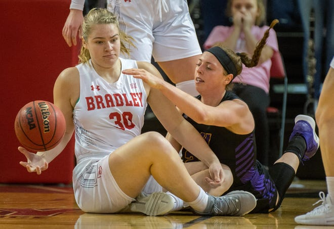 Bradley women's basketball player Emily Marsh (30) scrambles for a loose ball during a game last season at Renaissance Coliseum in Peoria.