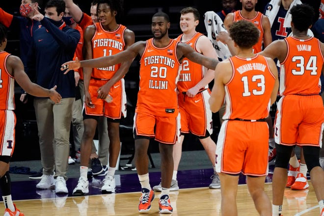 Illinois guard Da'Monte Williams (20) celebrates with teammates after they defeated Northwestern in Evanston, Thursday, Jan. 7, 2021. [Nam Y. Huh/The Associated Press]