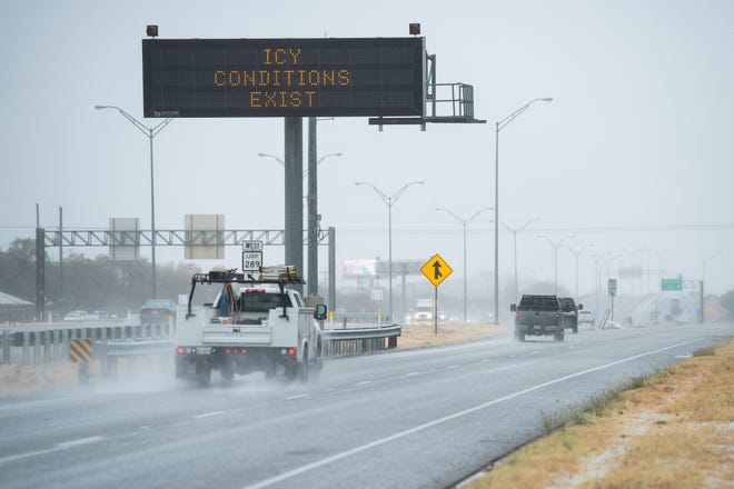 An electronic Texas Department of Transportation highway sign warns Lubbock area drivers of icy road conditions.